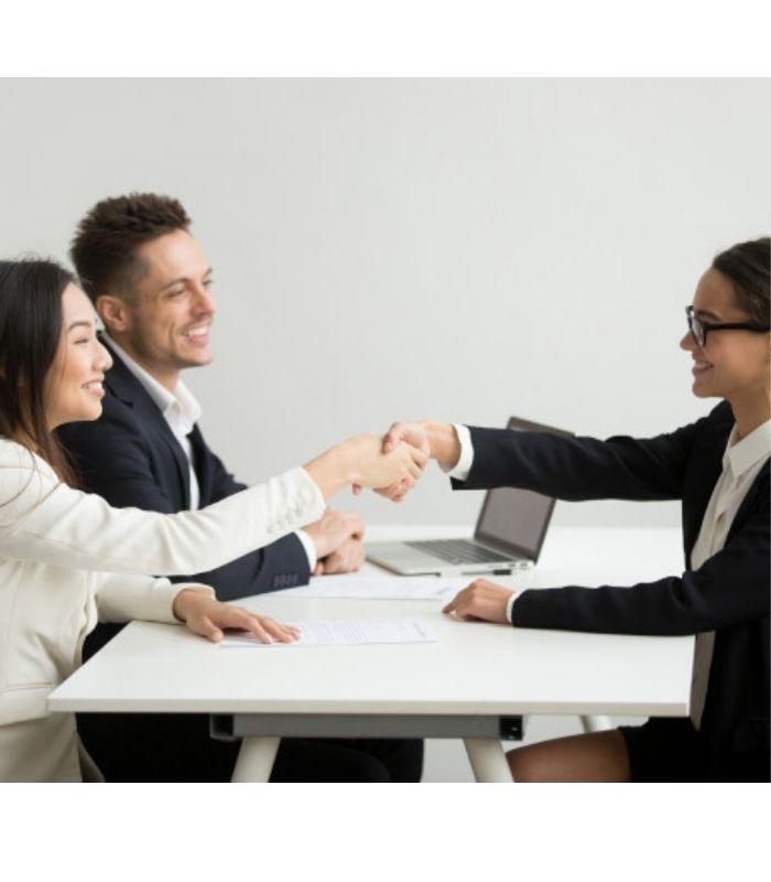 smiling-diverse-businesswomen-shake-hands-group-meeting-deal-concept_1163-4686